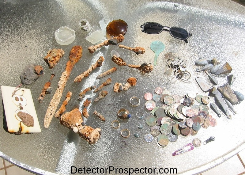 Iron junk, rings, coins, aluminum trash, and lead weights found metal detecting