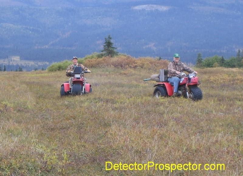 Using Honda 3-wheelers to run supplies over hill to stuck D9 bulldozer