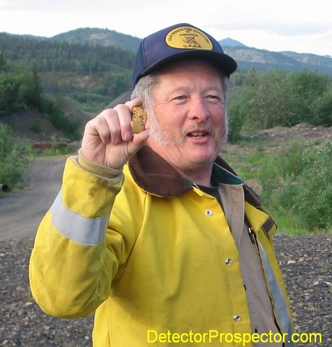 john-pulling-gold-nugget-ganes-creek.jpg