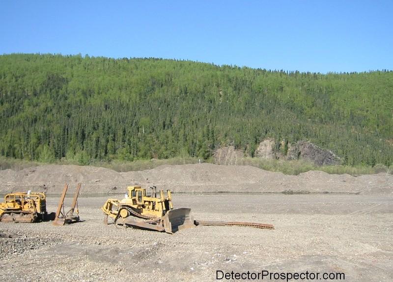 Tailing piles along airstrip at Ganes Creek