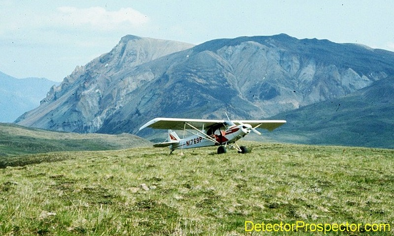 Super Cub N1769P parked on knoll in Talkeetna Mountains